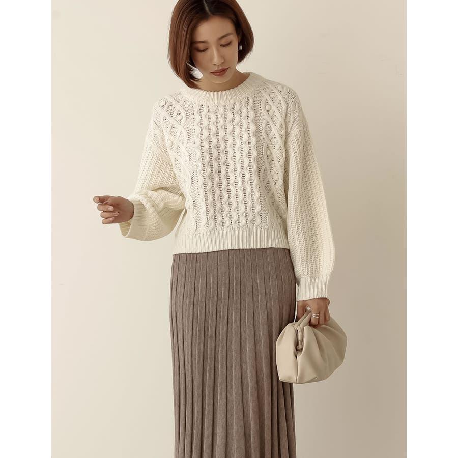 立体感のある編み目が愛らしいニットトップス 16