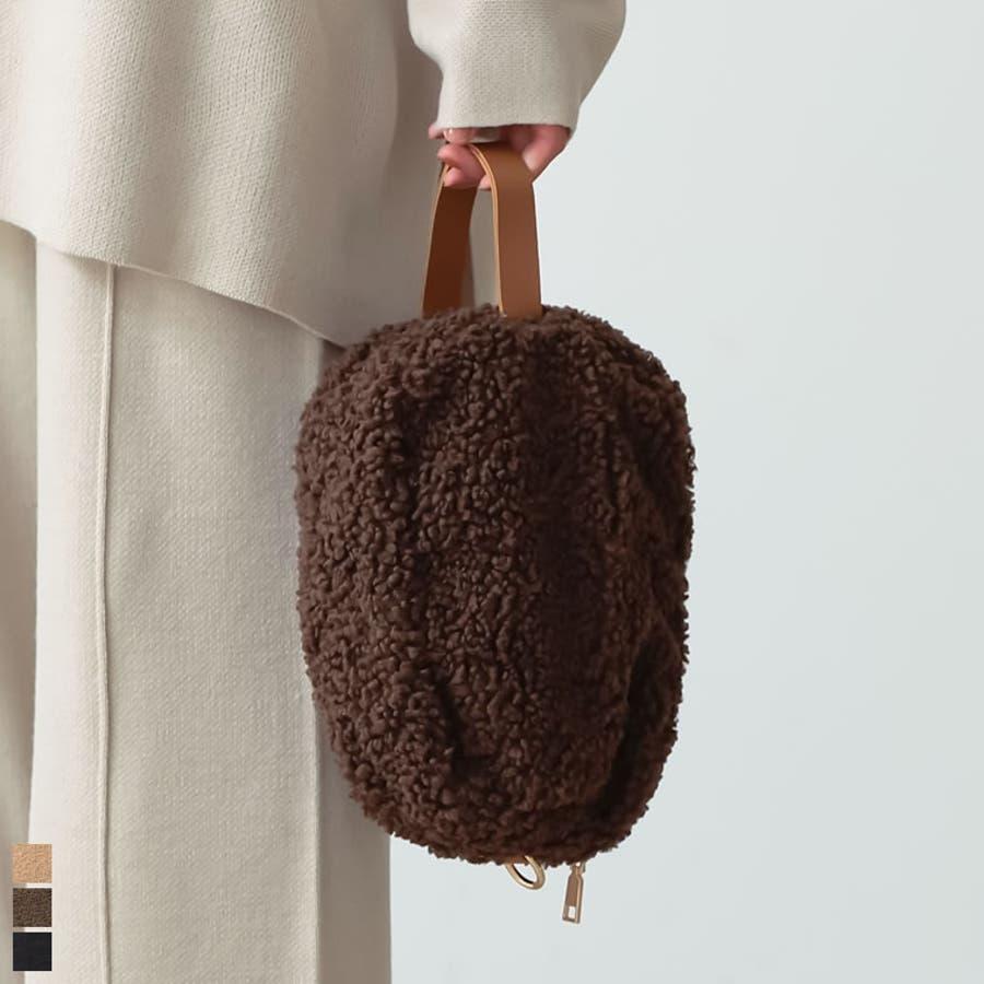 丸いシルエットがフェミニンなハンドバッグ フェイクボアハンドバッグ バッグ 1