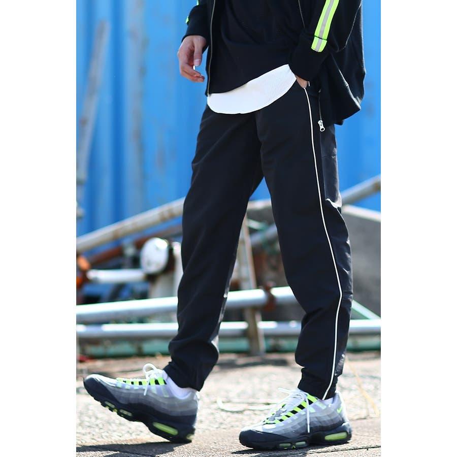 ナイロンパンツ メンズ レディース 白 ジョガーパンツ スポーツ サイドライン ラインパンツ 韓国 ファッションシャカシャカパンツシャカパン ダンス ヒップホップ トラックパンツ 黒 ホワイト ブラック 蛍光 イエロー ネオンカラーimproves 21