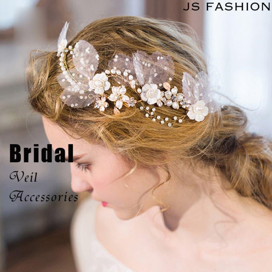 ウェディングドレスと合わせて ホワイトフラワーヘア飾り 結婚式